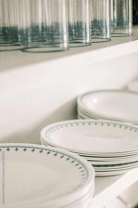 Plates and Drinking Glasses on Kitchen Shelf by Raymond Forbes LLC for Stocksy United