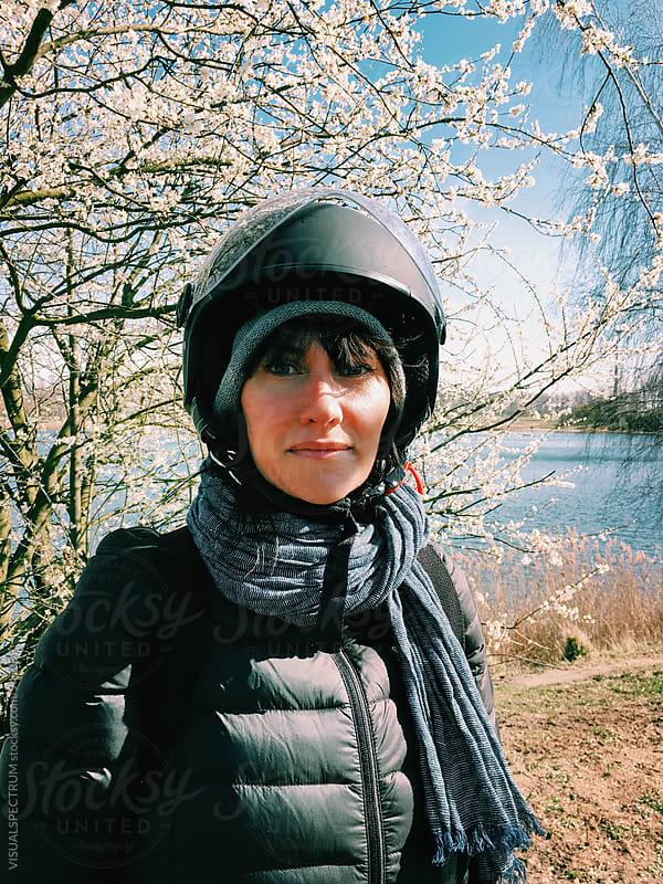 Outdoor Portrait of Pretty Woman Wearing Motorbike Helmet by Julien L. Balmer for Stocksy United