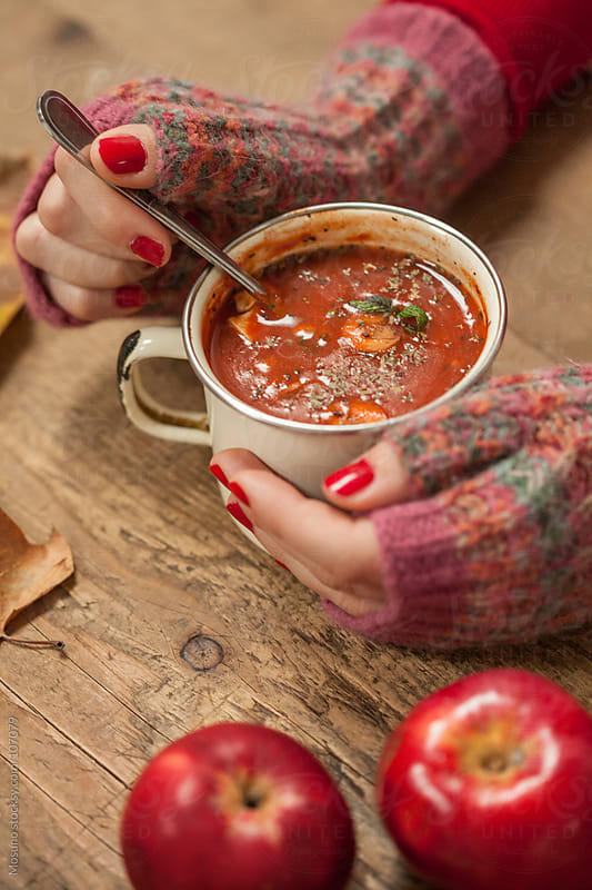 Woman Eating Hot Tomato Soup by Mosuno for Stocksy United