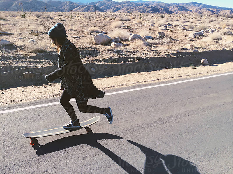 Woman Riding Longboard Down Road by Kevin Russ for Stocksy United