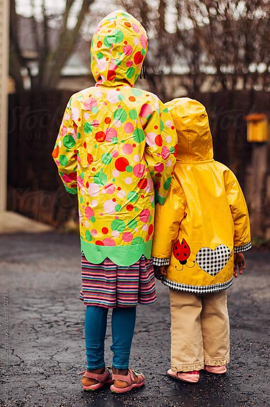 Two African American sisters in raincoats by Gabriel (Gabi) Bucataru for Stocksy United