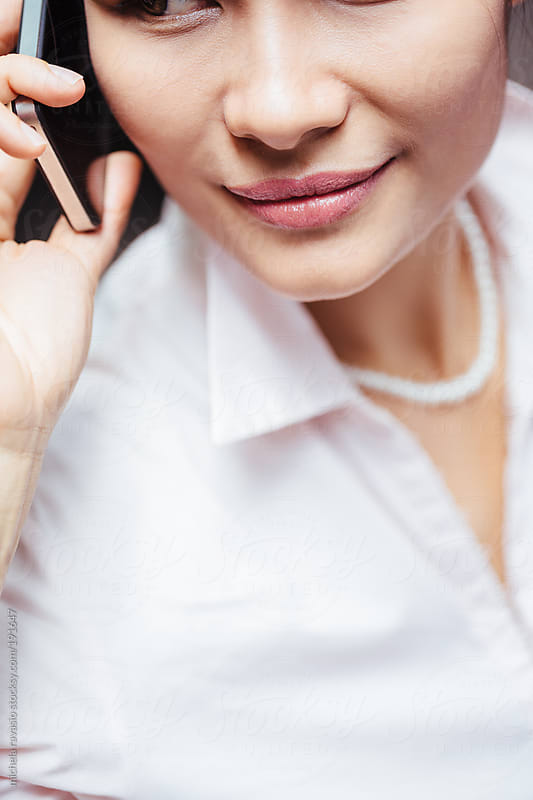 Close up of business woman on mobile phone by michela ravasio for Stocksy United