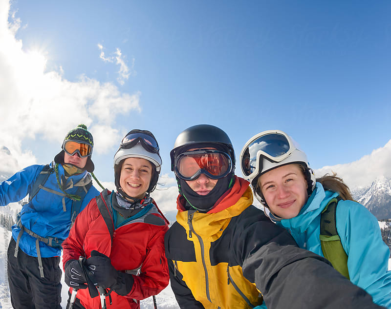 Friends having fun outdoor skiing by RG&B Images for Stocksy United