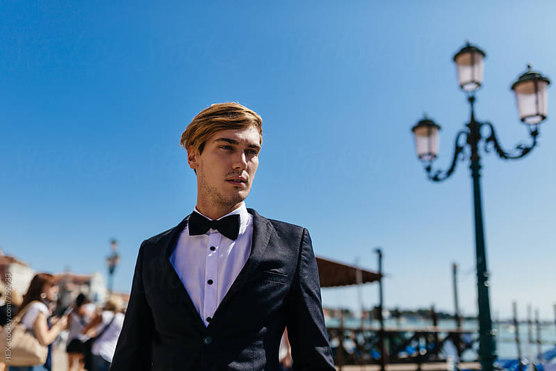 Elegant Young Man Walking in Venice Italy by Mattia Pelizzari for Stocksy United