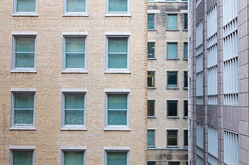 windows and tall buildings by Margaret Vincent for Stocksy United