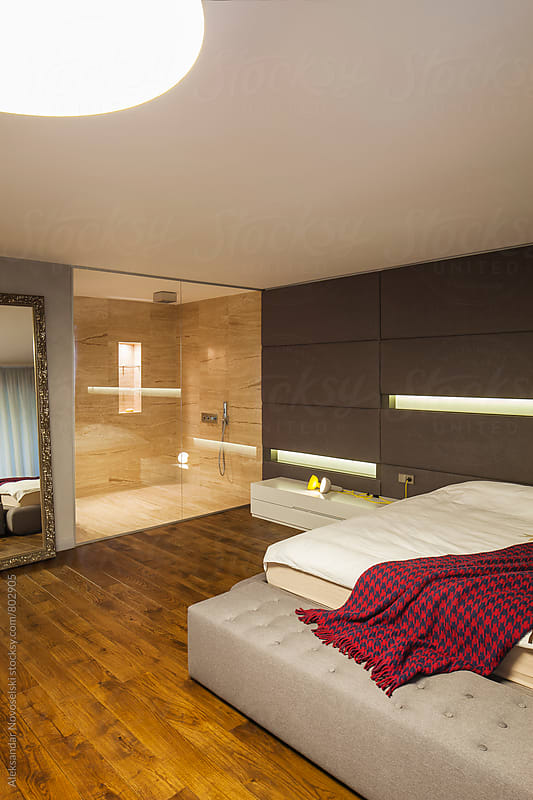 Modern bedroom and bathroom in contemporary interior by Aleksandar Novoselski for Stocksy United