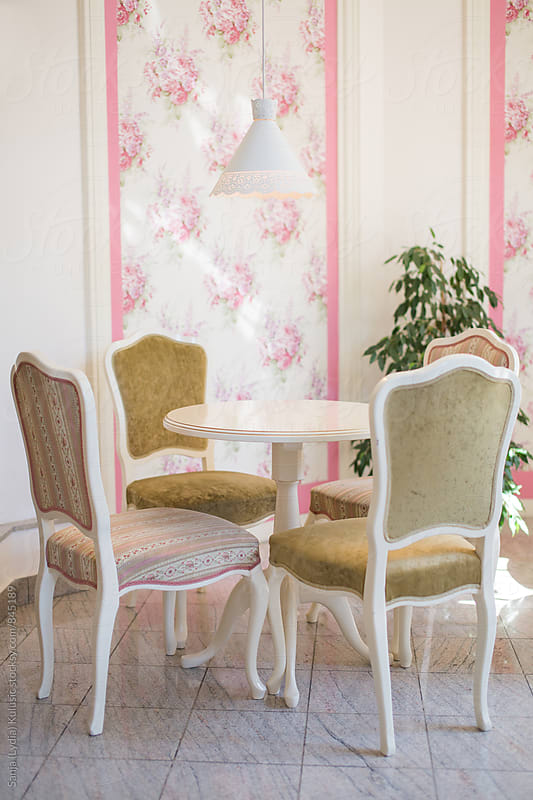 Pretty vintage set with table and chairs with a flora background by Sanja (Lydia) Kulusic for Stocksy United