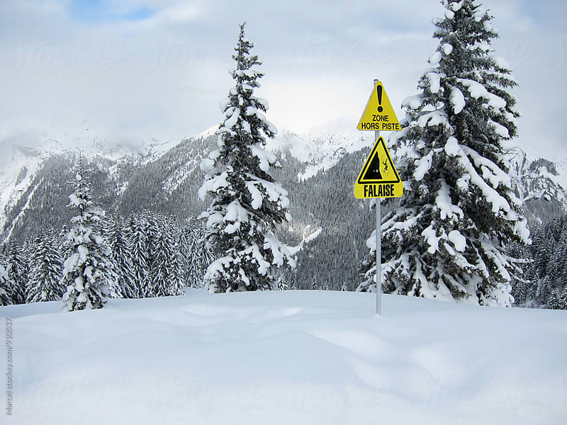 Warning sign on skipiste in France by Marcel for Stocksy United
