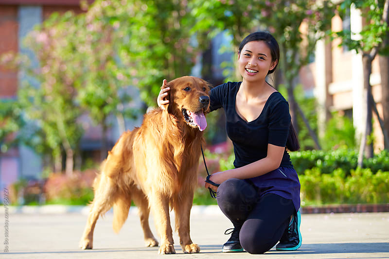 young woman with her dog outdoor by Bo Bo for Stocksy United