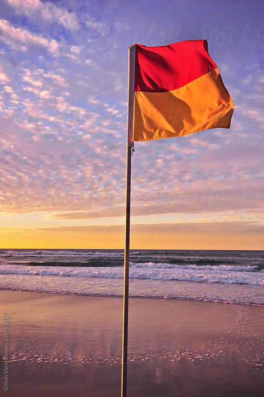 beach safety flags by Gillian Vann for Stocksy United