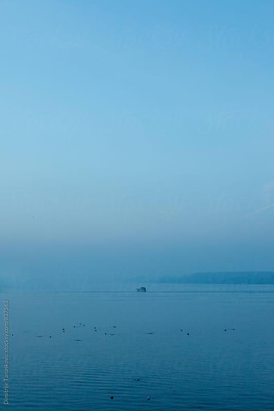Winter sunset on the river by Dimitrije Tanaskovic for Stocksy United