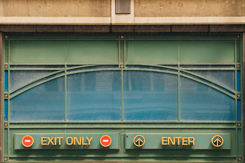 Exit and Enter signs by Adam Nixon for Stocksy United