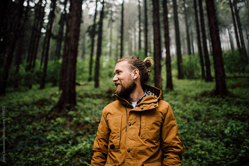 Portrait of man smiling in the forest by Boris Jovanovic for Stocksy United