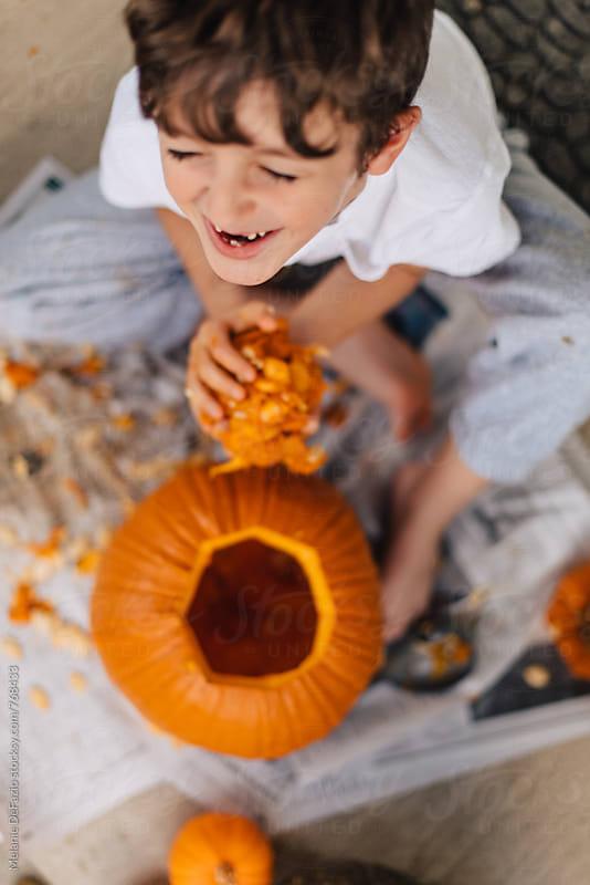 Carving pumpkins by Melanie DeFazio for Stocksy United