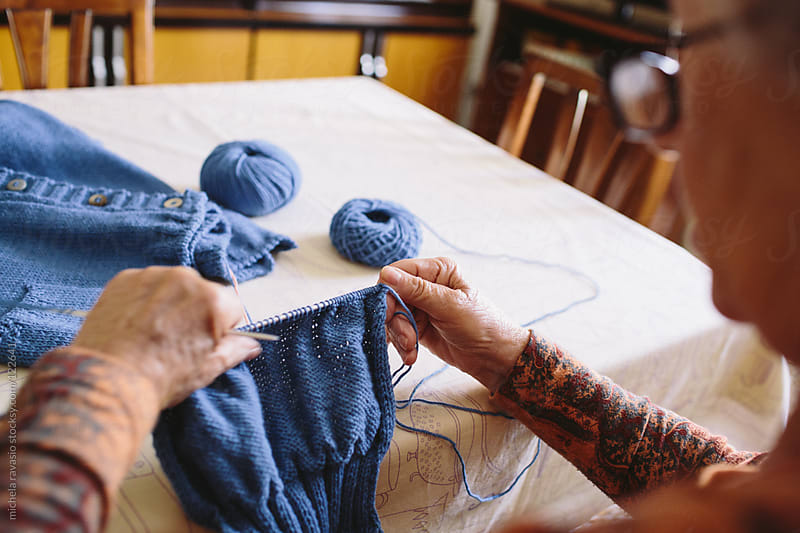 Elderly woman knitting by michela ravasio for Stocksy United