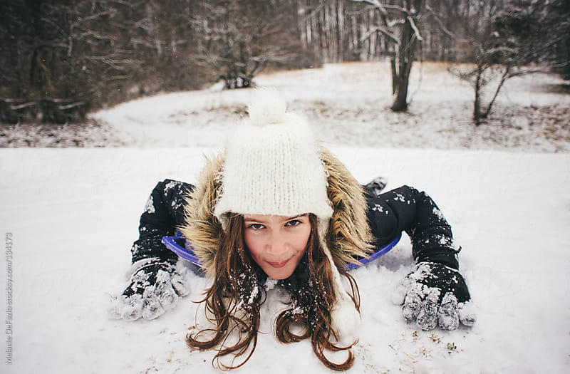 Sledding by Melanie DeFazio for Stocksy United