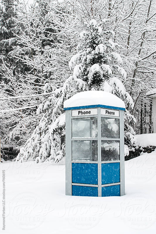 Phone Booth in Winter Storm by Raymond Forbes LLC for Stocksy United