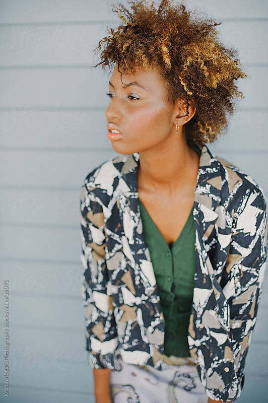 Stylish Teenage Model with Afro by Kristin Rogers Photography for Stocksy United