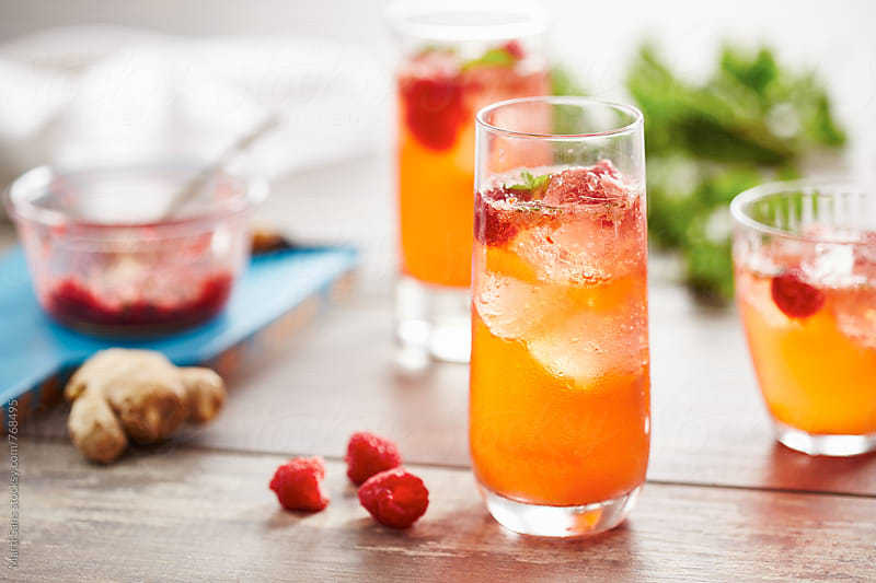 Raspberry fizz cocktail by Martí Sans for Stocksy United