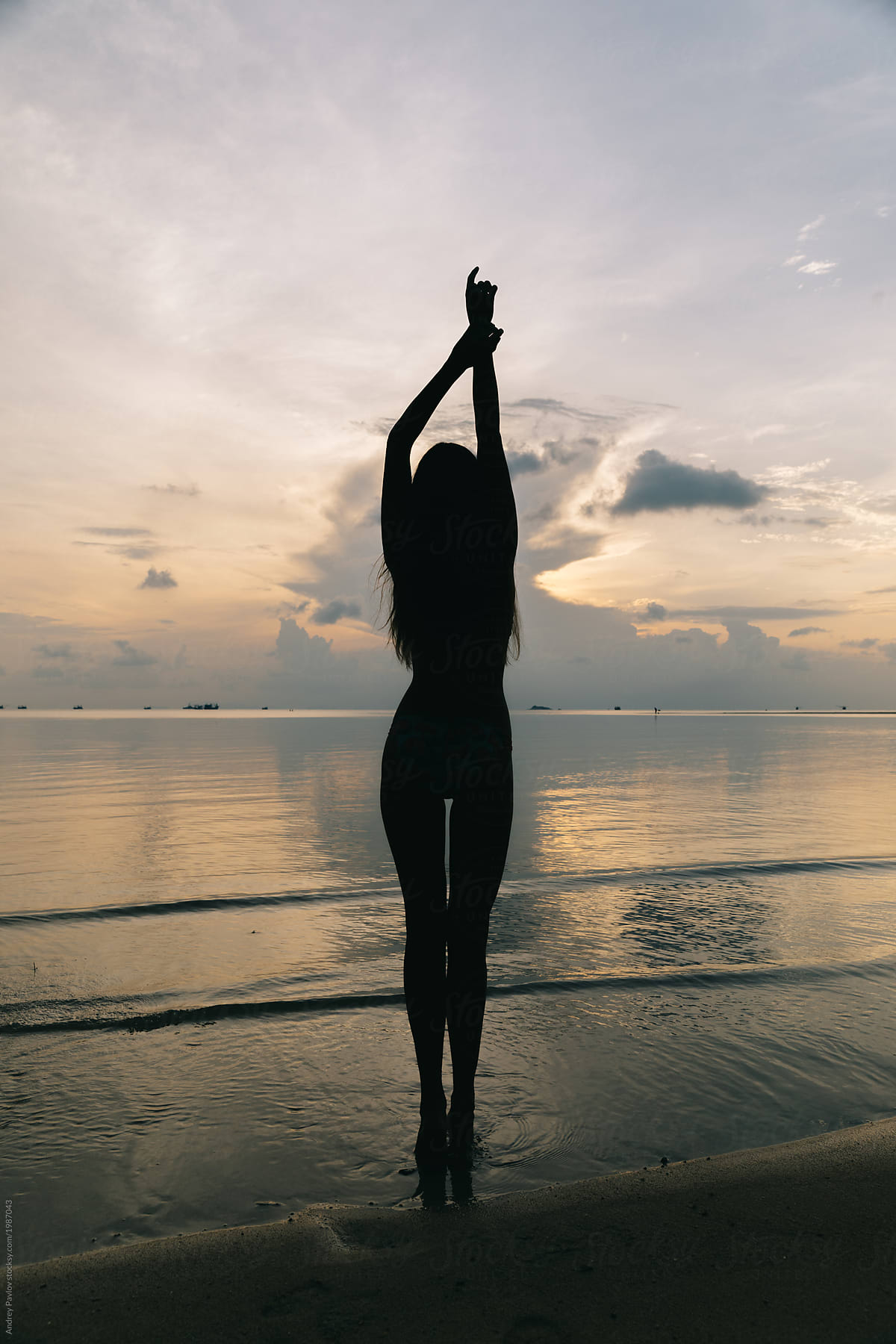 Silhouette Of A Beautiful Woman On The Beach  Stocksy United-8639