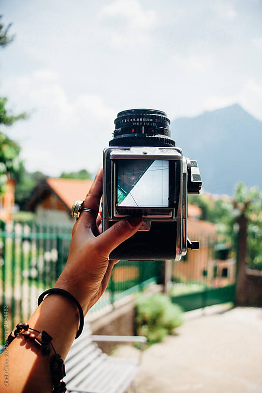 Woman holding a medium format analog camera by Giada Canu for Stocksy United