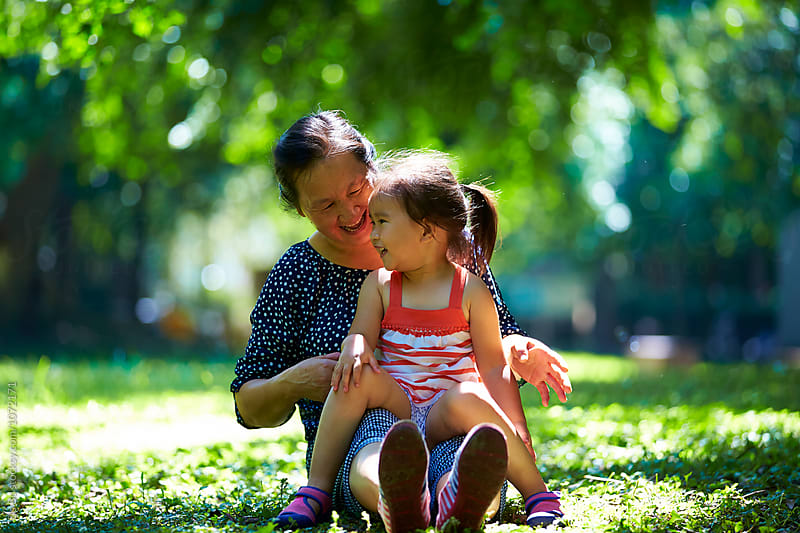 grandmother with granddaughter in the sunny park by Bo Bo for Stocksy United