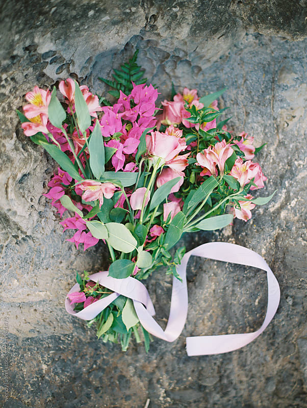 pink bridal bouquet on grey ocean rock by wendy laurel for Stocksy United