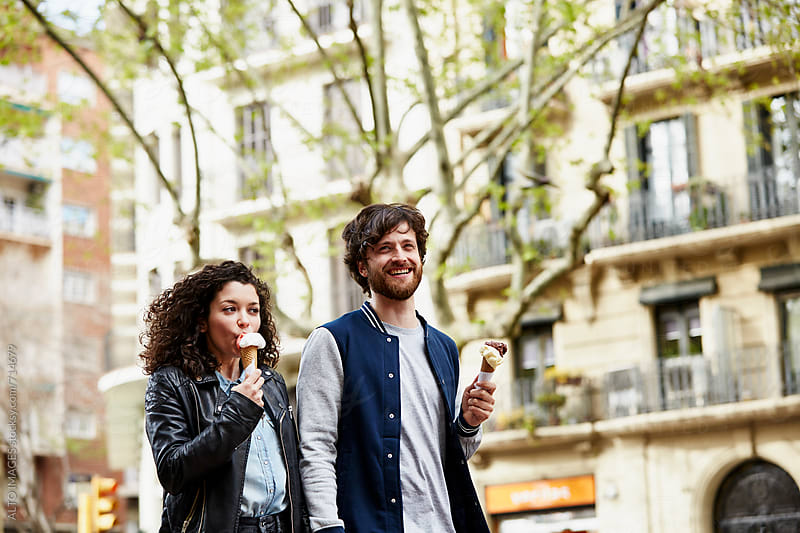 Couple Having Ice Creams In City by ALTO IMAGES for Stocksy United