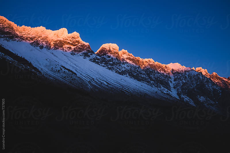 Mountain peaks in Patagonia at sunset by Leandro Crespi for Stocksy United