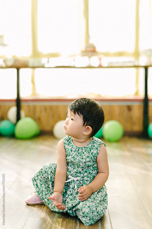 Toddler girl sitting on floor by MaaHoo Studio for Stocksy United