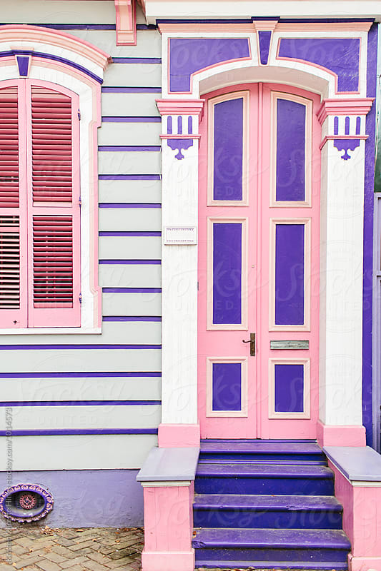 A colorful pink & purple front porch in the French Quarter in New Orleans by Kristen Curette Hines for Stocksy United