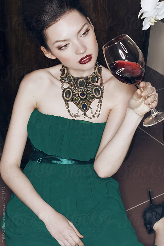young beautiful woman in bar with red wine by T-REX & Flower for Stocksy United