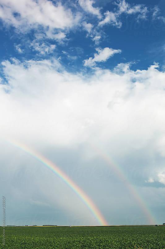 double rainbow over farmland by Kelly Knox for Stocksy United