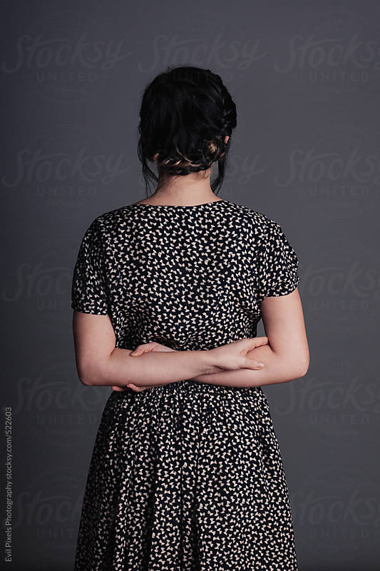 Portrait of a young beautiful lady in vintage dress from back  by Evil Pixels Photography for Stocksy United