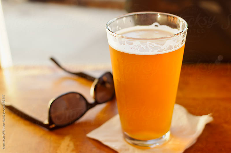 IPA Beer and Sunglasses by Cameron Whitman for Stocksy United