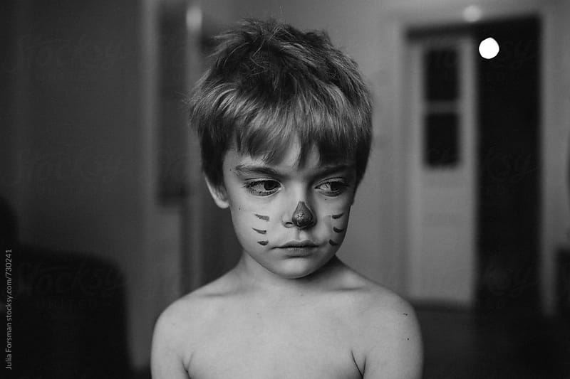Cute little boy who has drawn whiskers on his face. by Julia Forsman for Stocksy United