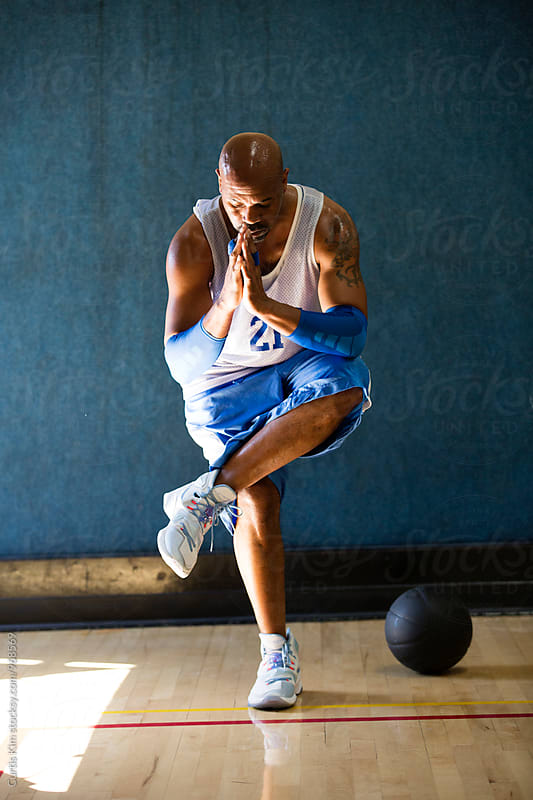 Basketball player in pre-game workout by Curtis Kim for Stocksy United