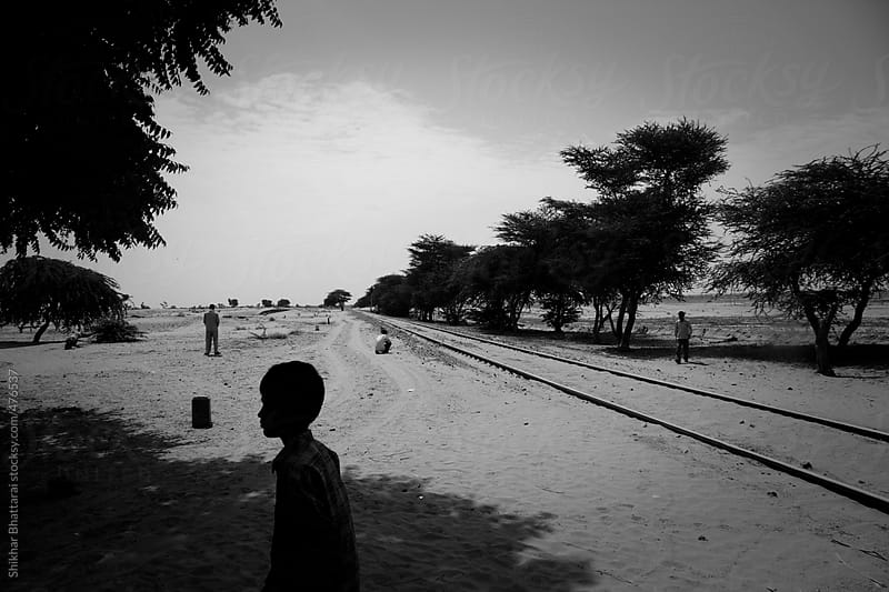 People along the railway tracks in Rajasthan, India. by Shikhar Bhattarai for Stocksy United