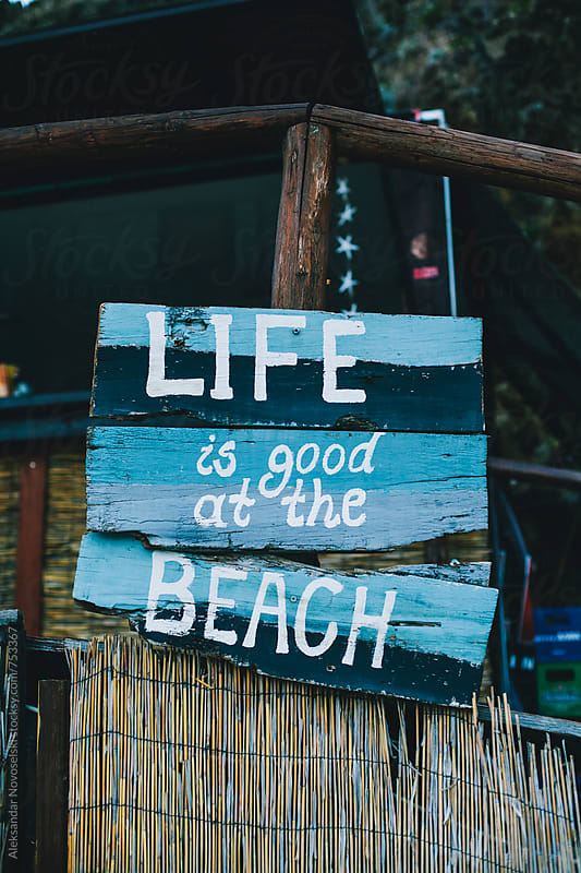 'Life is good at the beach' sign at a beach bar by Aleksandar Novoselski for Stocksy United
