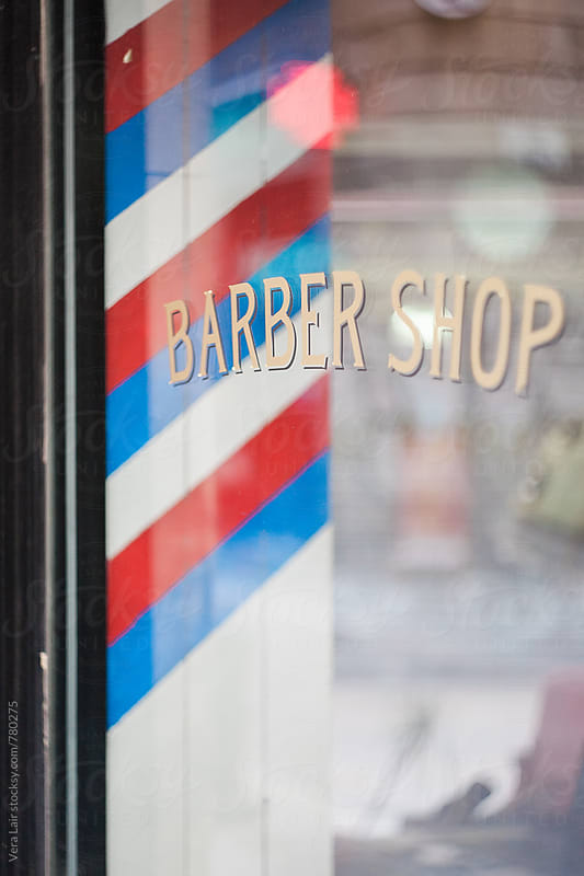 Barber shop window by Vera Lair for Stocksy United