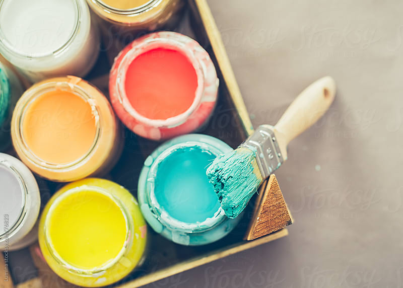 Paintbrush and Various Paints by Lumina for Stocksy United