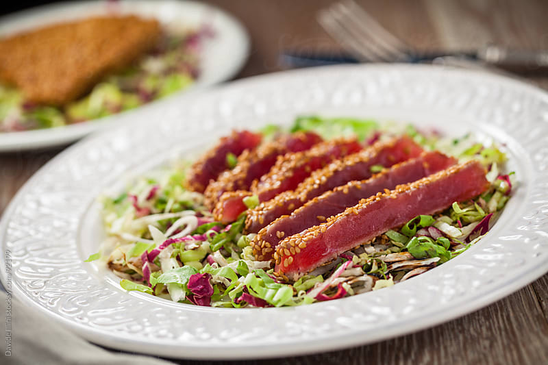 Seared tuna with sesame seeds by Davide Illini for Stocksy United