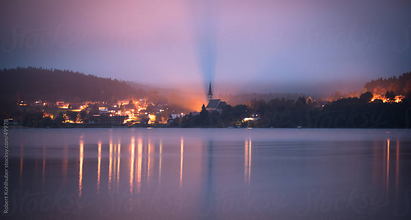 Village at a lake on twilight at dusk by Robert Kohlhuber for Stocksy United