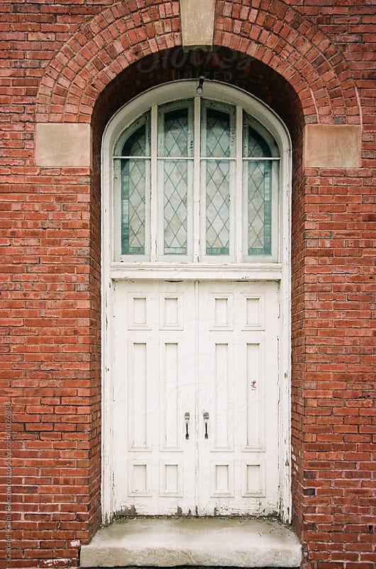 White old church door  by Gabriel (Gabi) Bucataru for Stocksy United