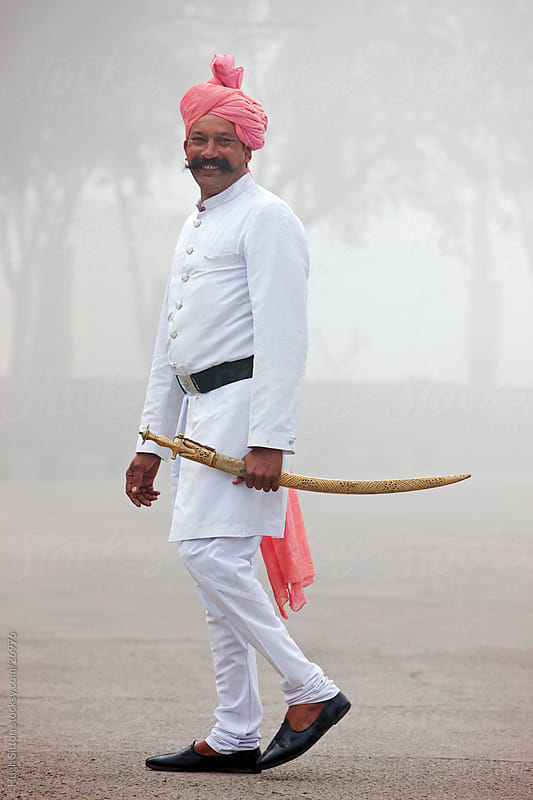 Palace Guard in the early morning mist. Rajasthan. by Hugh Sitton for Stocksy United
