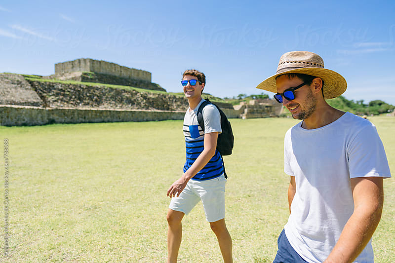 Two young men travelers walking through ancient ruins landmark in Mexico by Alejandro Moreno de Carlos for Stocksy United