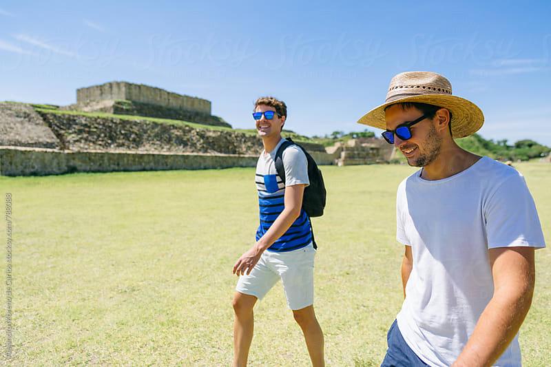 Two young men travelers walking through ancient ruins landmark in Mexico by Alejandro Moreno de Carlos for Stocksy United