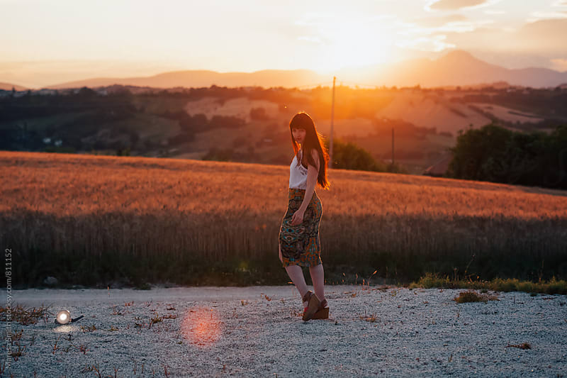 A brunette woman at sunset, in rural Italy by Maresa Smith for Stocksy United