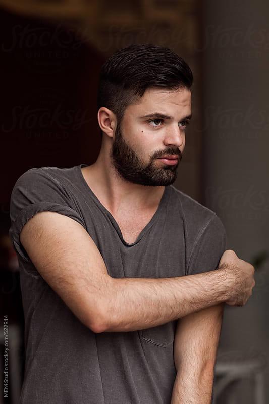 young bearded man portrait by MEM Studio for Stocksy United