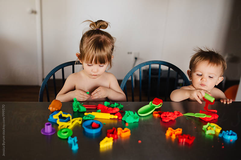 Sibling Play Dough Fun by Jessica Byrum for Stocksy United